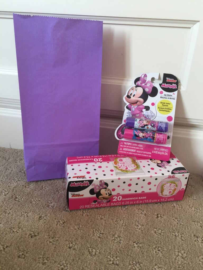 Road Trip activities featured by top US family travel blog, Travel with a Plan: Minnie-themed road trip activitybag