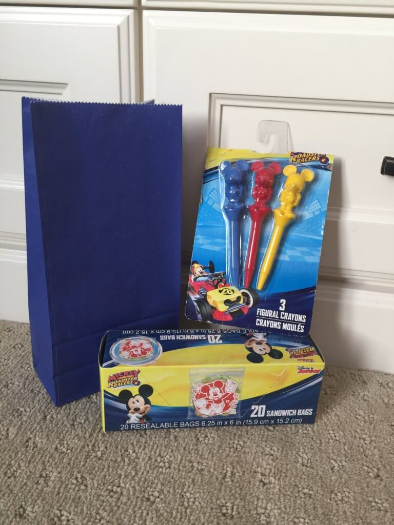 Road Trip activities featured by top US family travel blog, Travel with a Plan: Mickey road trip activity bag