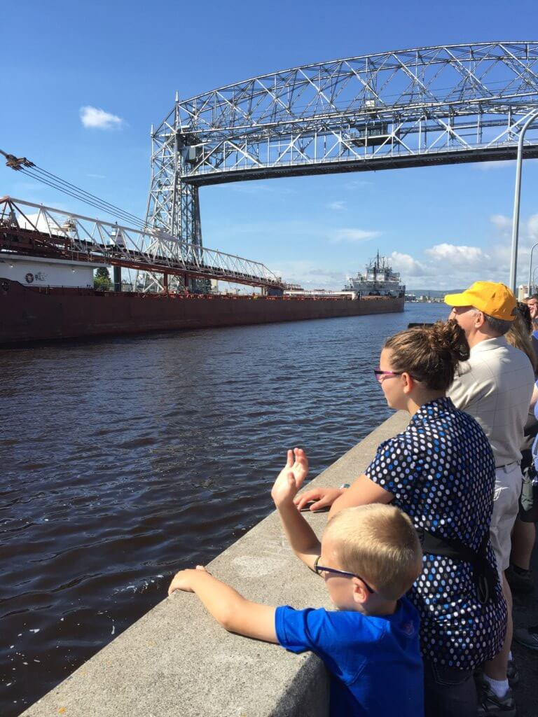 Boys watching Duluth lift bridge