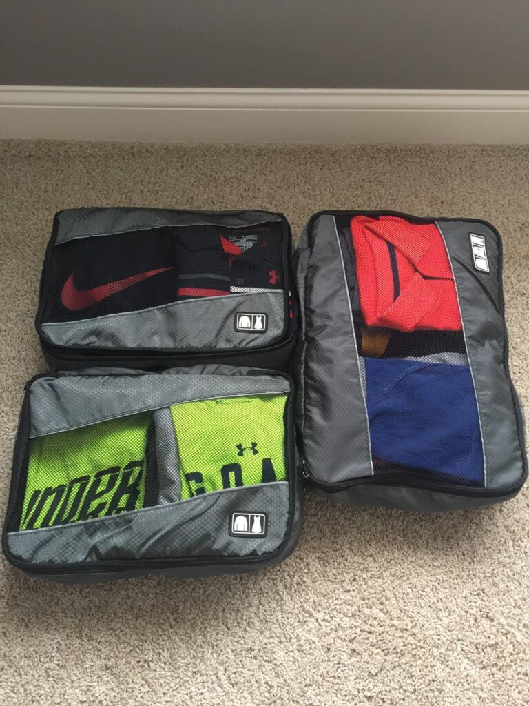 packing cubes with clothes in them utilizing packing tips