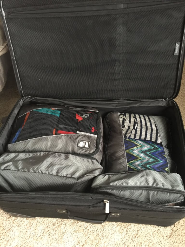 packing suitcase using family vacation packing tips