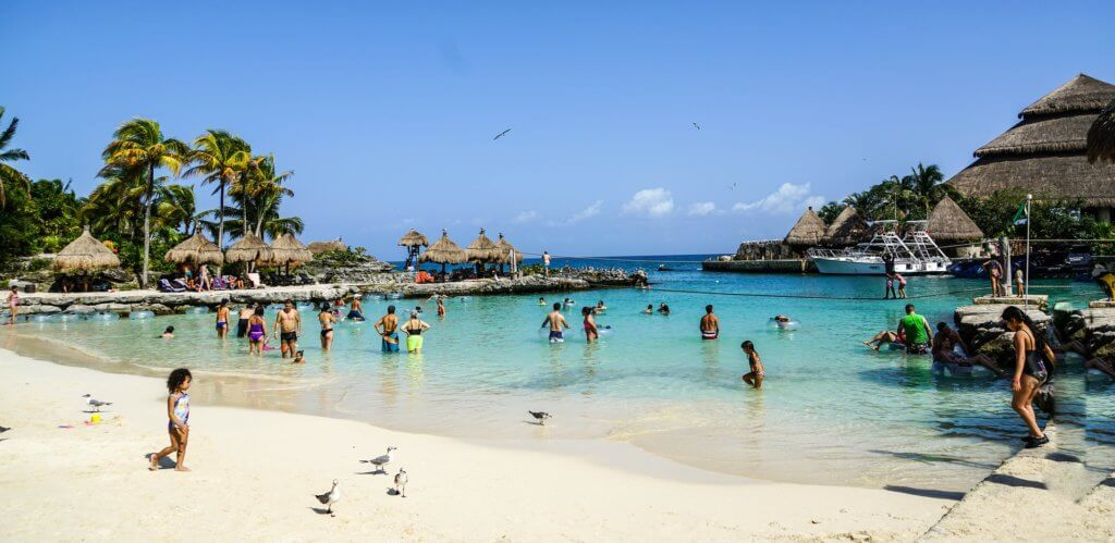 Top US Travel Blog, Travel With A Plan uncovers how to pick and plan an Kid-Friendly All-Inclusive family vacation! Swimming at all-inclusive family vacation