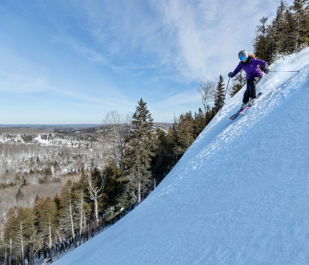 Looking for the best Midwest USA downshill skiing?  Lutsen Mountains Ski Resort is by far the best skiing in Minnesota and will become your family favorite!  Learn all about Lutsen and what to expect from Top U.S. travel blog, Travel With A Plan.  #skiinginMinnesota #Lutsen #Minnesotaskiing #snowboardinginMinnesota #winteractivities #bestplacestoski