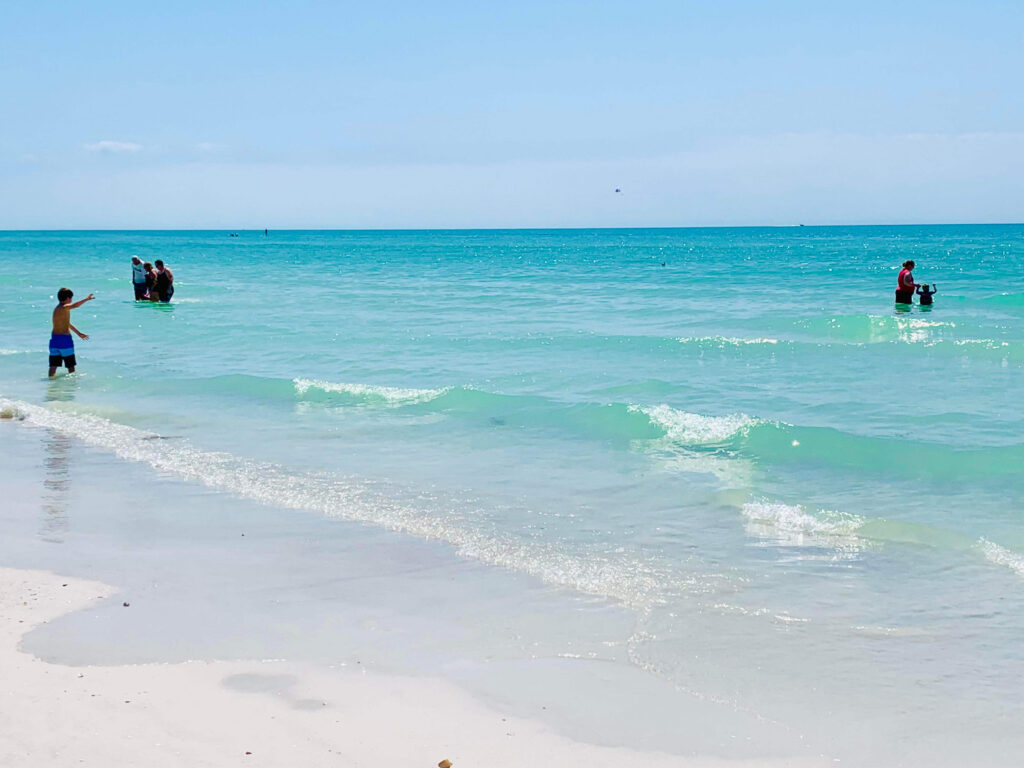 Things to do in Siesta Key; swim in the clear waters at Crescent Beach
